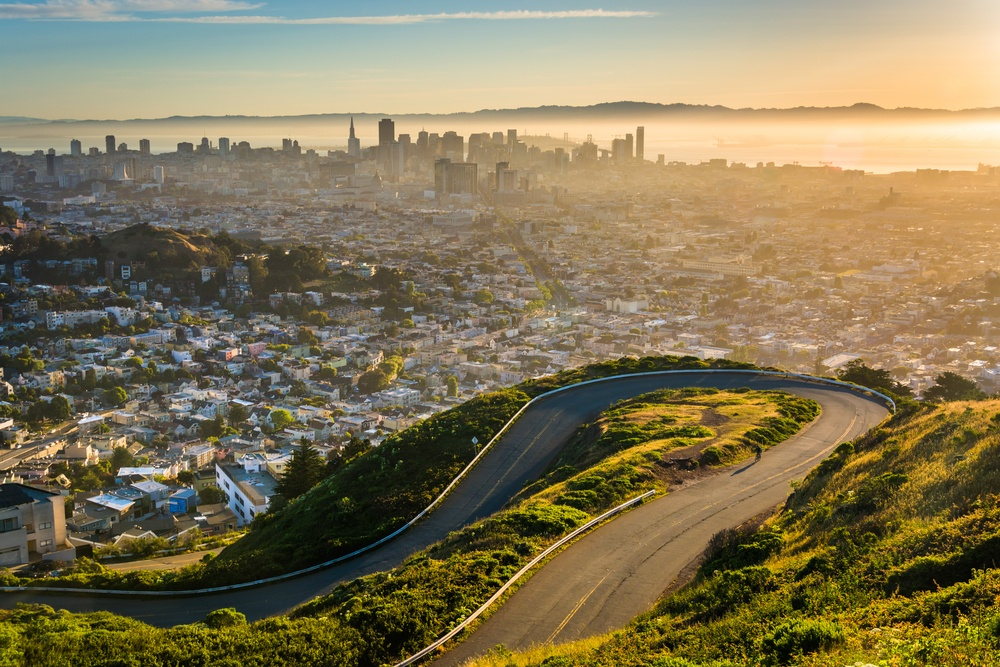 Curvy road and view of downtown at sunrise from Twin Peaks, in San Francisco, California..jpeg